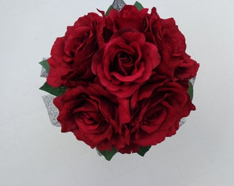 Bridesmaid bouquet in open red roses