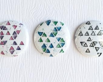 "3 badges 1 ""Mixed media Triangles"
