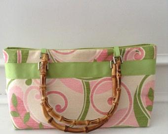 Pink and green swirl handbag