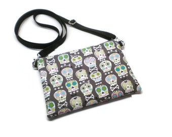 Sugar skulls mini sling bag, cross body purse, cell phone purse. With credit card pockets and adjustable strap.