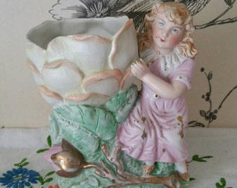 Vintage Bisque porcelain spill vase of a young girl holding a flower.