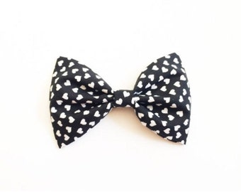 Black and white heart bow