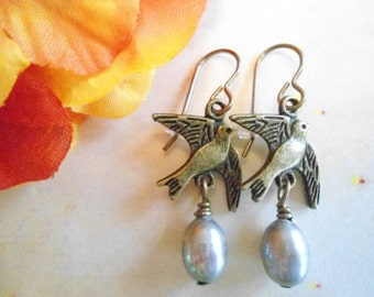 Grey bird earrings:  Light grey dyed and cultured teardrop pearl antique brass earrings with vintaj brand earring hooks nickel and lead free