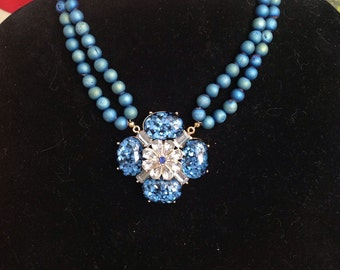 Double strand blue necklace, blue and crystal focal piece (recycled), gold tone multi-length clasp.