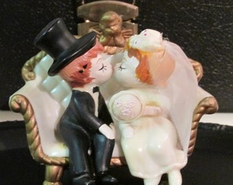 1970 Wilton Wedding Cake Topper - Kissing Couple on a Couch with Cupid