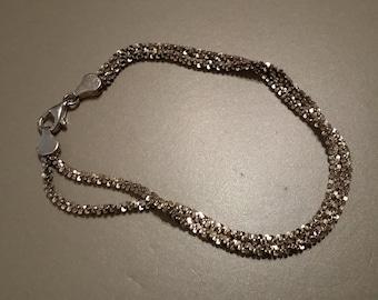 B 9  sterling silver double stranded bracelet.