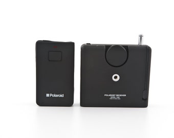 Polaroid Spectra Transmitter (Model 7020) and Receiver (Model 7030) accessory with soft carrying case