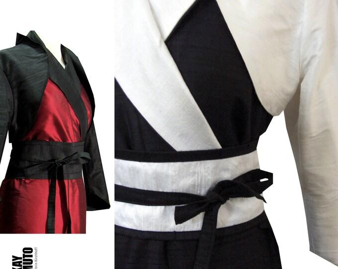 costum combination: wrapdress and bolero, colored in black and white  three quarter sleeve