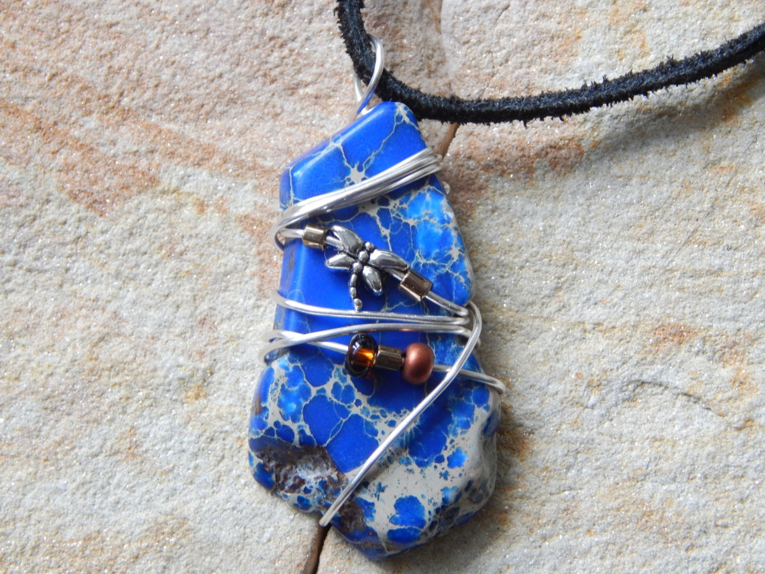 wire wrapped blue gemstone pendant sea sediment imperial