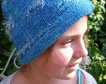 variegated light blue/light green beaded cuff hat with white fluff accents