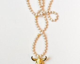 longhorn pendant + cream magnesite necklace ||  gold electropladed longhorn