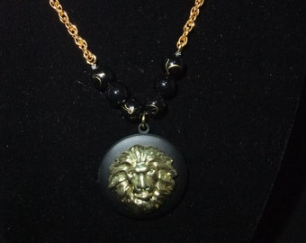 Black & Gold Lion Locket (Black Beads w/ Gold Chain)