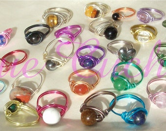 Ring aluminum and semiprecious stones in the choice