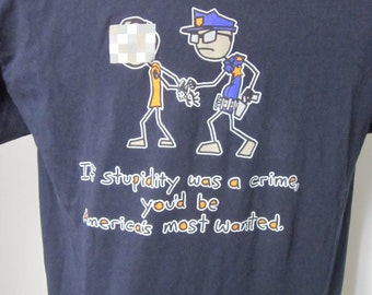 "Vintage ""If Stupidity Was a Crime, You'd Be America's Most Wanted..."". -Short Sleeve Navy Blue Large Cotton Shirt"