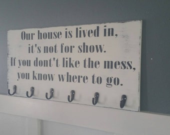 Our house is lived in, it's not for show If you don't like the mess you know where to go hand painted distressed wood sign with hooks