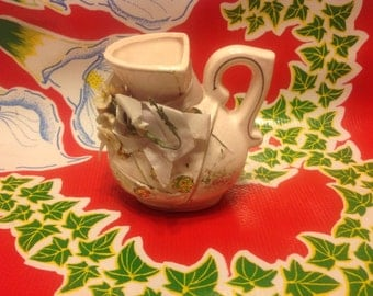 Vintage miniature ceramic pink pitcher with gold accents and floral designs