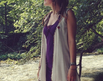asymetric long vest with flowery trim