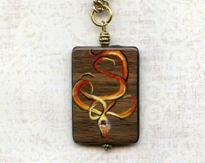 HAND PAINTED PENDANT Jewelry,art,flames,embossed,wood-look bead,16 inch gold metal chain, Swarovski crystal, wearable art, reversible,