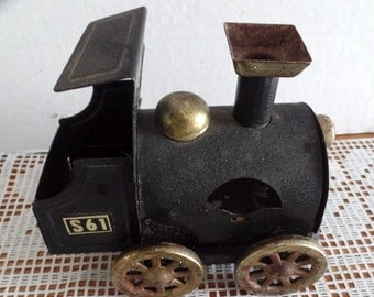 Old metal, toy train car/ engine.  It is all metal, and marked: S61.