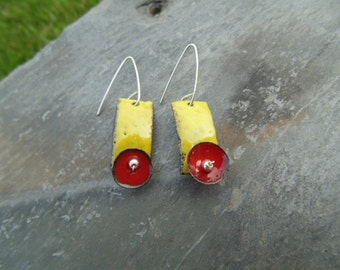 Bright Red Circles hang from Bright Yellow Stems