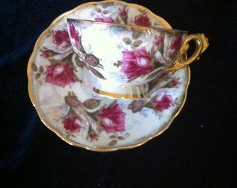 Opalescent Gilded Tea Cup and Saucer