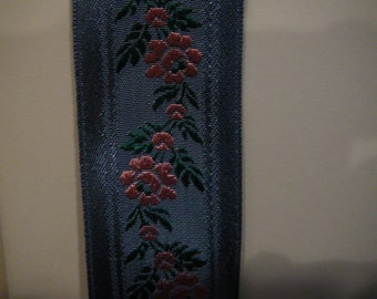 """1 3/8"""" heavily  woven slate blue ribbon with pink roses"""