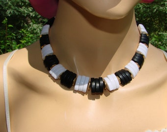 1980 black and white beaded choker style necklace. Classic retro perfect with jeans and a tee.