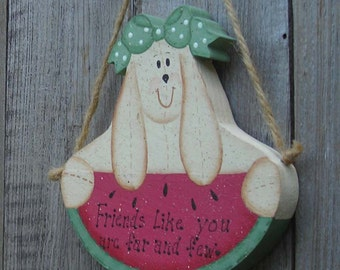 Friends like you are far and few.  Wooden sign. Rabbit, watermelon