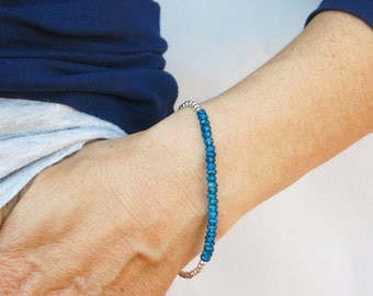 Apatite  bracelet with  sterling silver faceted round beads.  Brilliant blue apatite bracelet.