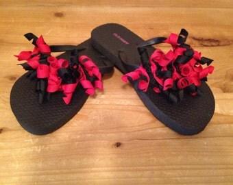 Red and black korker flip flops