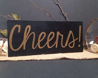 """3 1/2""""x8"""" black and gold """"Cheers!"""" wood sign"""