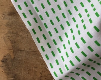 Bright Green dot design printed on white Kona cotton. Hand screen printed fabric.