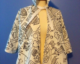 REDUCED! Color me happy cape with 8 crayons will look great on your child  ages 3-10