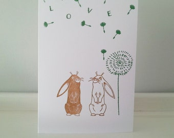 Rabbit Greeting Card / Anniversary Card: Bunnies, Wishing For Love under a Dandelion Seed Cloud.