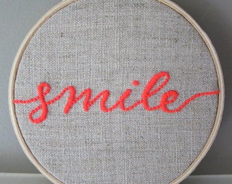 """Hand Embroidered 4"""" Hoop Art Neon Pink """"Smile"""" Calligraphic Quote Saying on Natural Unbleached Linen"""