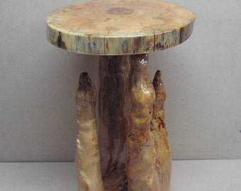 Spalted gum and cypress knee table, with great color and fun shape.