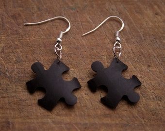 Jigsaw earrings made from bicycle inner tubes