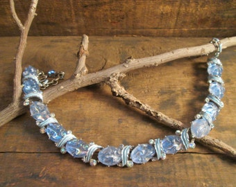 rare vintage enamel, molded blueish plastic with aurora borealis rhinestone necklace