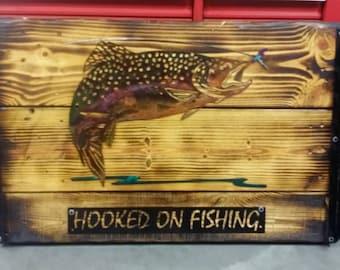 Rainbow trout fishing pole holder