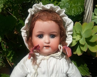 Antique bisque head doll. Heubach Koppelsdorf 275. Collectable dolls. Vintage. Old. German bisque doll.
