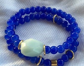 Royal blue stack bracelet with light aqua rock and gold accents