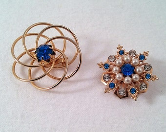 Two Vintage Blue Rhinestone Brooches in Gold Tone Metal