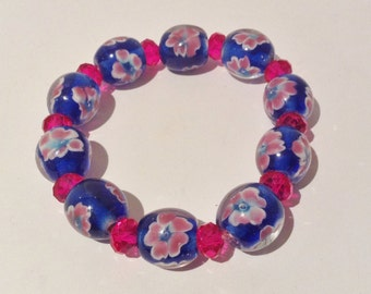 Bracelet 19cm Features High Quality Lampwork ovals. Blue with pink Floral pattern. Hot Pink Crystal faceted rondel spacers