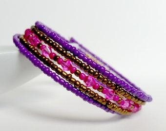 Swarovski crystals Dark gold, Purple, and hot pink glass beads Memory wire bracelet. Wrap bracelet