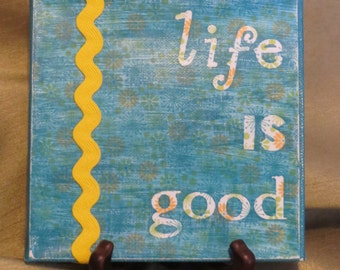 """Yellow and turquoise """"Life is Good"""" canvas with stand"""