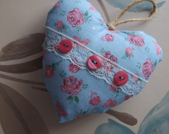 hanging heart,vintage blue with floral pattern ,lace with pink buttons across,simply beautiful