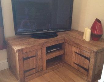 Tv corner unit made from reclainef hardwood.