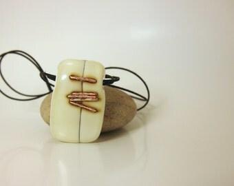 Cream fusing glass pendant.