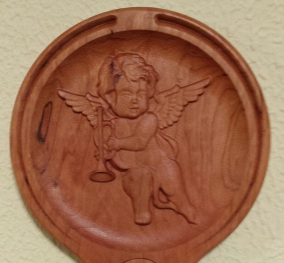 Hand held quot mirror relief carving cherry wood cherub