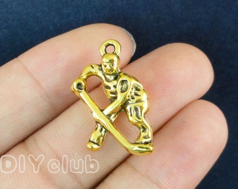 12pcs of Antique Gold Hockey Player Charm pendants, Hockey Charms 24x15mm